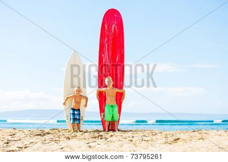Young Boys With Surfboards on the Beach in Hawaii. Going Surfing.