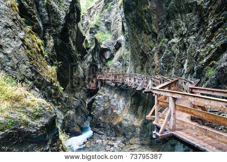 Wooden Walkway Over The Rough River