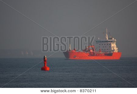 Red Bulk Freighter with Red Buoy