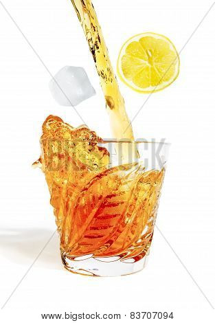 Whiff Of Alcohol Pours With Splashes Into The Glass With Ice And Lemon