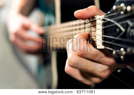 Man Playing On The Acoustic Guitar