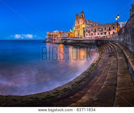 Balluta Bay And Church Of Our Lady Of Mount Carmel In Saint Julien, Malta