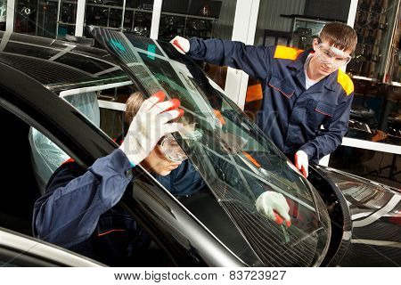 Two Real Mechanics working in Auto Repair Shop poster
