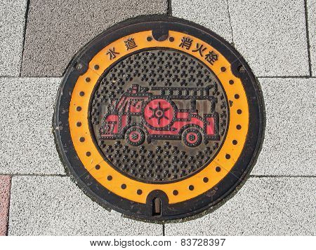 Manhole drain cover on the street at Tokyo, Japan poster