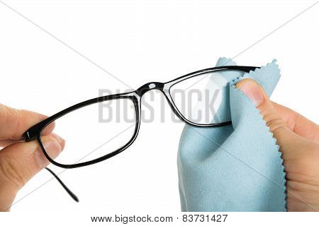 Close-up Of Person's Hand Cleaning Eyeglasses With Cloth poster