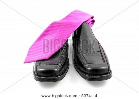 Pair Of Black Male Business Shoes And Pink Tie