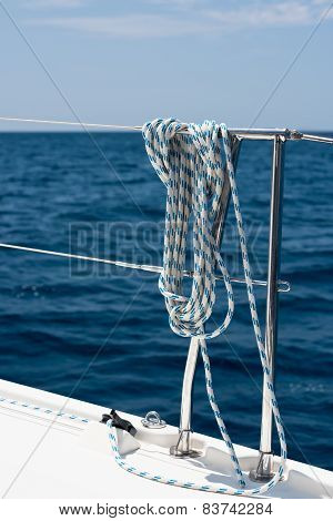 A Rope Tied Around A Lifeline On A Yacht