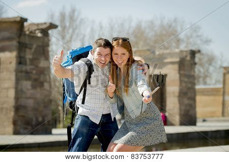 Young American Student And Tourist Couple Visiting Egyptian Monument Taking Selfie Photo With Stick