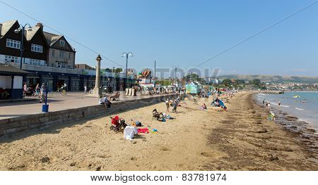 Summer sun and warm weather brought visitors to Swanage beach on the Dorset coast