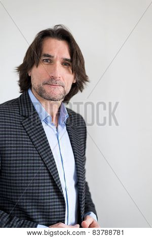 man in a checkered jacket on  light background