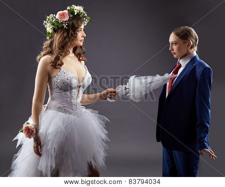 Gay marriage. Sexy bride pokes groom with umbrella