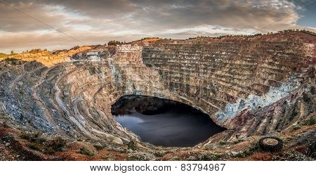 Panoramic an open pit mine with lake in the center