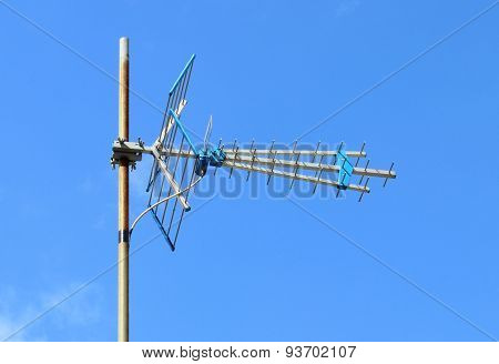 Television Antenna Home Receiver On A Blue Sky