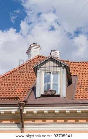 Authentic mansard window in a old style tiled roof poster
