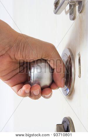 Hand On Aluminum Door Knob