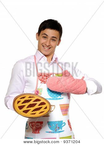 Cooking. Young Man In Apron Baked Tasty Pie. Isolated On White Background