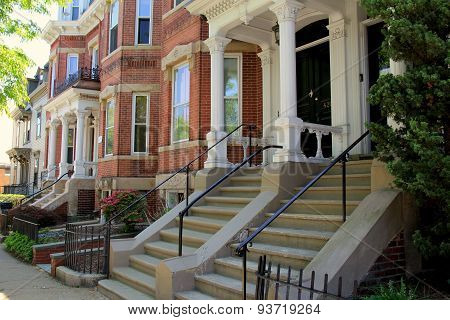 Gorgeous line of row houses on quiet city street