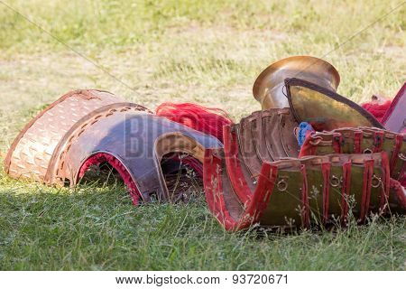 Ancient Roman armor of leather and metal lying on the ground poster