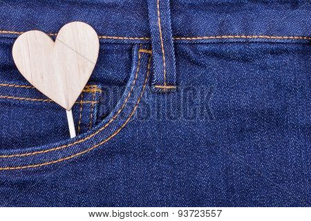 Wooden Heart Shape In The Pocket Of Jeans