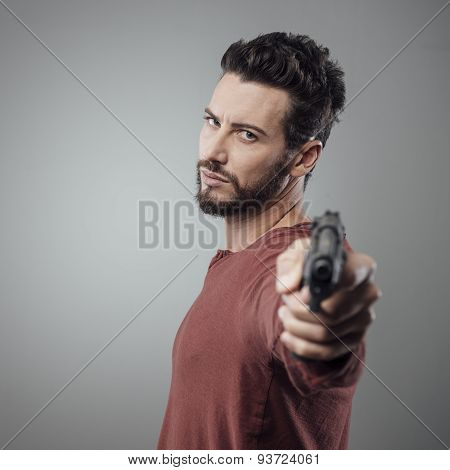 Cool Young Man Holding A Gun