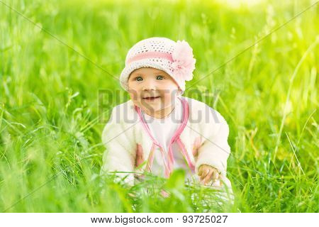 Summer Portrait Of Beautiful Baby Girl Sitting In Grass