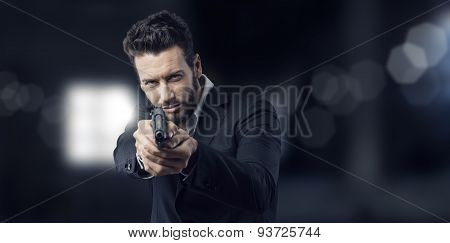 Cool Handsome Man Pointing A Gun