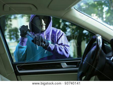 Man burglar stealing car poster