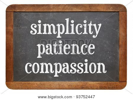 Simplicity, patience and compassion - three words from Buddha teaching on a vintage slate blackboard