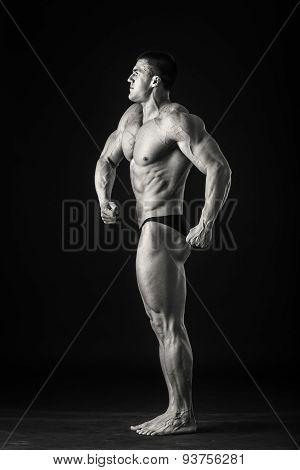 Handsome male bodybuilder. Bodybuilder posing on a black background