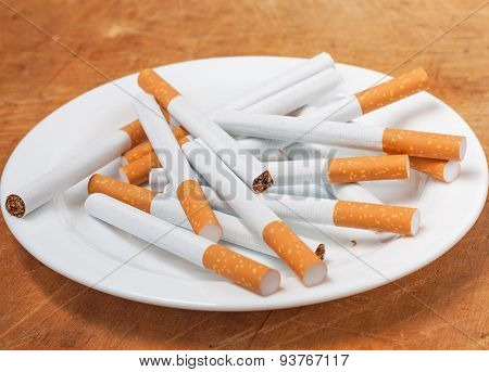 Many Cigarettes On The Plate