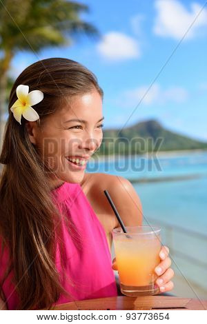 Beach bar party drinking friends toasting Hawaiian sunset cocktails having fun. Asian woman looking at camera holding alcoholic drink cheering in Waikiki beach, Honolulu city, Oahu, Hawaii USA. poster