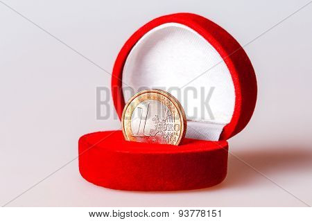 Red Gift Box With One Euro Coin, The Official Currency Of The Eurozone (european Union).