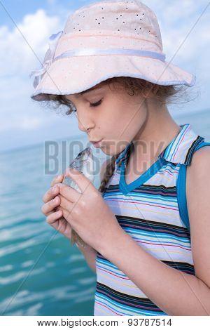 girl in panama kisses freshly caught fish poster