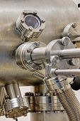 Detail of stainless steel machinery in physics laboratory poster