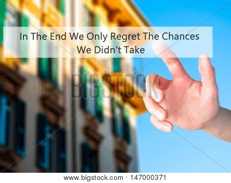 In The End We Only Regret The Chances We Didn't Take - Hand Pressing A Button On Blurred Background