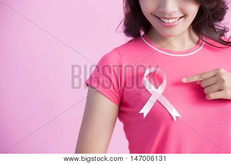 Happy Woman with pink ribbon and show it great for prevention breast cancer concept