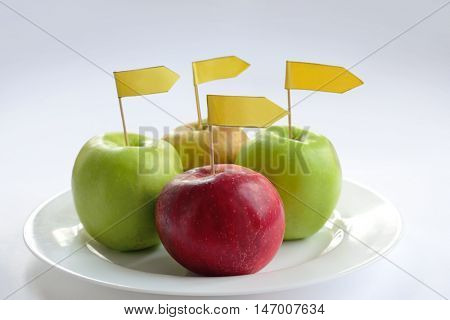 four apples with label on a plate
