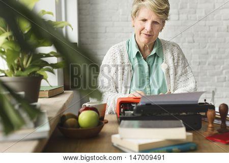 Senior Adult Using Typewriter Typing Concept