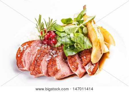 Roast goose breast on white plate, fine dining
