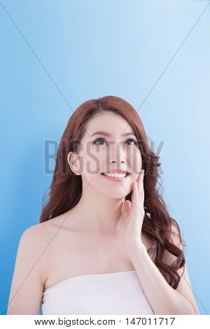 beauty woman smile and look copy space happily with isolated blue background asian