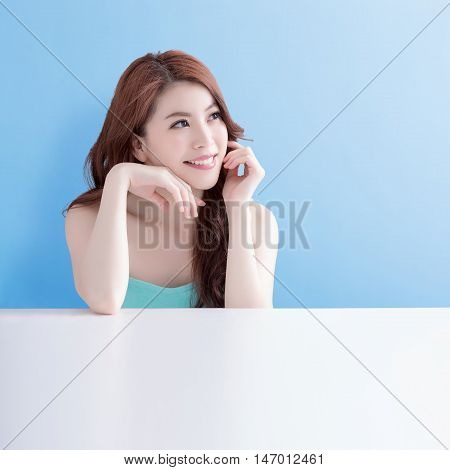 beauty skin care woman lying on the white table with blue background asian