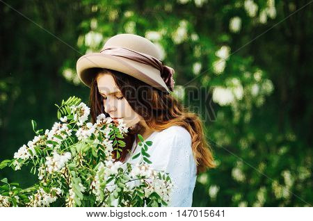 Portrait Of A Young Slim Beautiful Girl With Golden Wavy Hair We