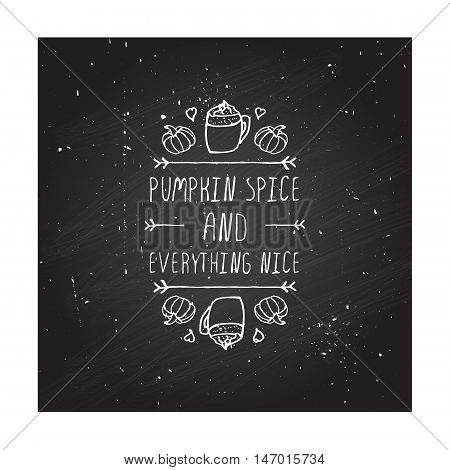 Hand-sketched typographic element with pumpkins, hearts, pumpkin spice latte and text on blackboard background. Pumpkin spice and everything nice