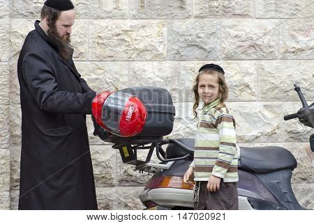 Orthodox Jewish Man And His Son With .scooter