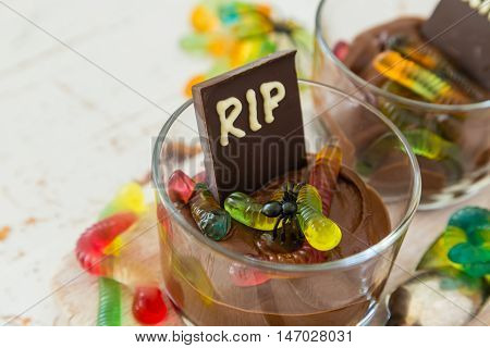 Chocolate mousse with gelly worm with halloween decorations