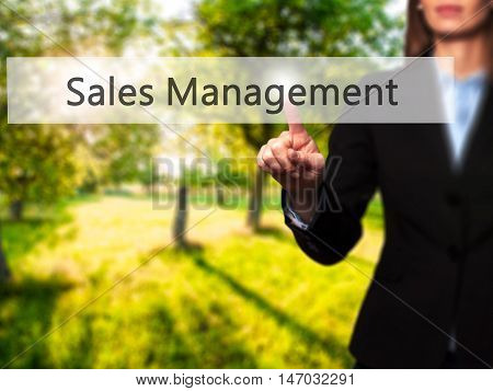 Sales Management - Businesswoman Pressing High Tech  Modern Button On A Virtual Background