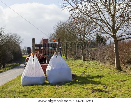 Red Loader With White Bags