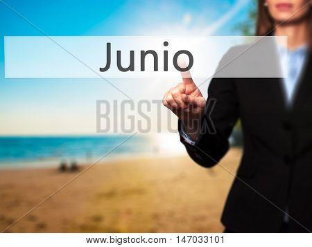 Junio (june In Spanish) - Businesswoman Pressing High Tech  Modern Button On A Virtual Background