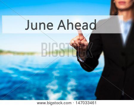 June Ahead - Businesswoman Pressing High Tech  Modern Button On A Virtual Background