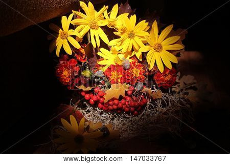 beautiful bright bouquet from bloom yellow flowers, rawberries, leaves nice gift of autumn